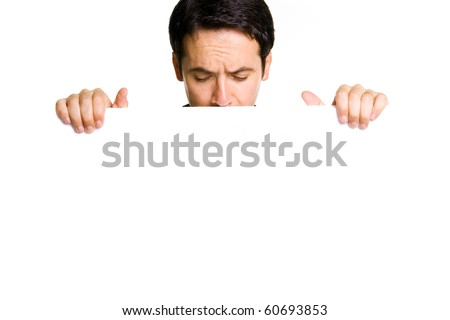 Potrait of a young man holding blank billboard - stock photo