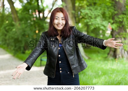 Potrait of happy asian girl with open arms