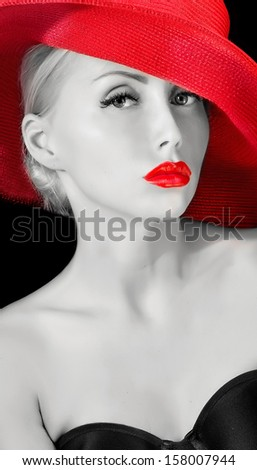 potrait of sexy elegant young woman in red hat