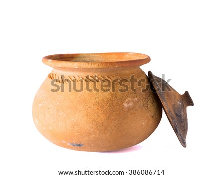 Pots made of traditional clay for use in the kitchen. On a white background