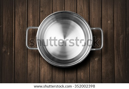 Pots  on a wooden kitchen bench - stock photo