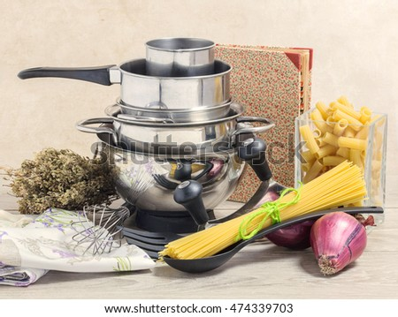 pots selection,recipe book, kitchen utensil and basic ingredients