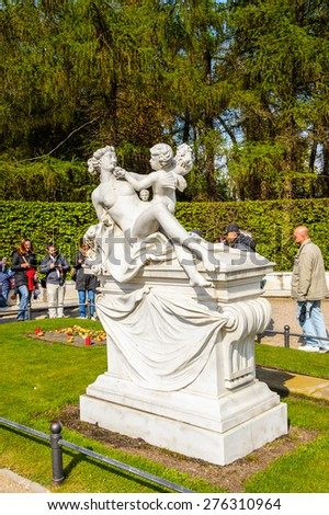 POTSDAM, GERMANY - APR 30, 2015: Statue near the Sanssouci Palace, the former summer palace of Frederick the Great, King of Prussia, UNESCO World Heritage - stock photo