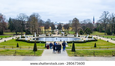 POTSDAM, GERMANY, MARCH 11, 2015: people are strolling among gardens and fountains adjacent to the sanssouci palace in potsdam, germany. - stock photo