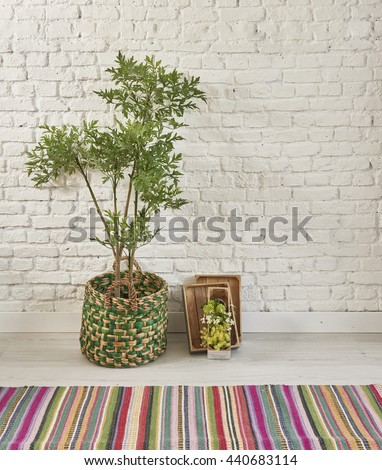 potted green plants brick wall and carpet style interior vintage decor - stock photo