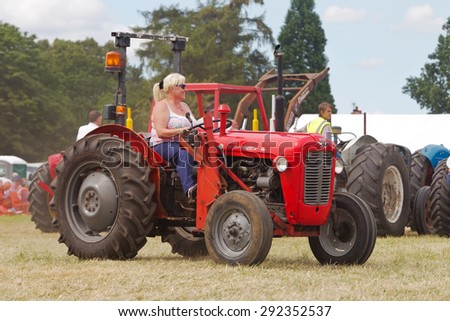 POTTEN END, UK - JULY 27: A Massey Ferguson tractor is paraded around the main arena as part of the agricultural machinery show at the Dacorum Steam & Country fair on July 27, 2014 in Potten End