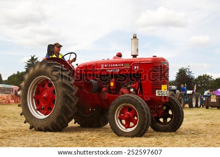 POTTEN END, UK - JULY 27: A McCormick standard tractor is paraded around the main arena as part of the agricultural machinery show at the Dacorum Steam & Country fair on July 27, 2014 in Potten End
