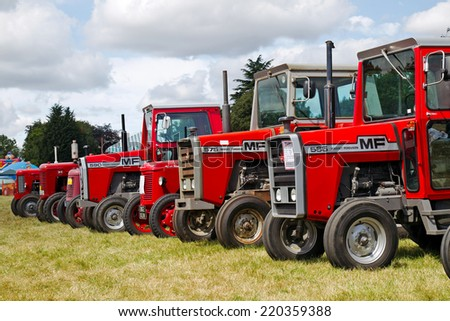 POTTEN END, UK - JULY 27:A static display of vintage Massey Ferguson tractors is one of the attractions in the agricultural section at the Dacorum Steam fair on July 27, 2014 in Potten End  - stock photo