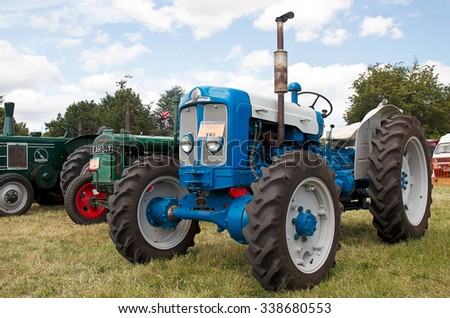 POTTEN END, UK - JULY 27: A Super Major vintage tractor stands on static display for the public to view at the Dacorum Steam & Country fair on July 27, 2014 in Potten End