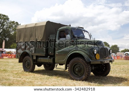 POTTEN END, UK - JULY 27: A vintage Austin troop carrier lorry exits the show arena having just given a public display at the Dacorum Steam Fair on July 27, 2014 in Potten End.