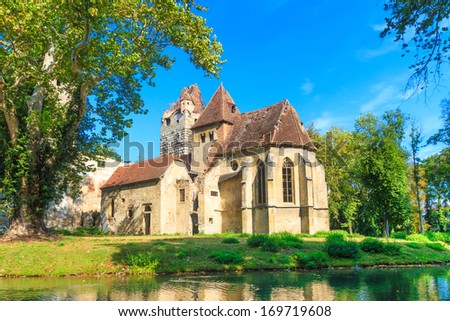 Pottendorf Castle and Gothic Church Ruins near Eisenstadt, Austria - stock photo