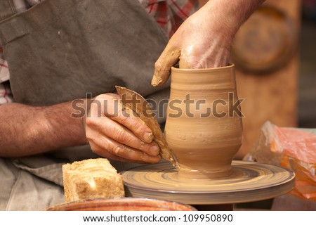 Potter and clay - stock photo