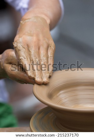 Potter makes a jug out of clay.