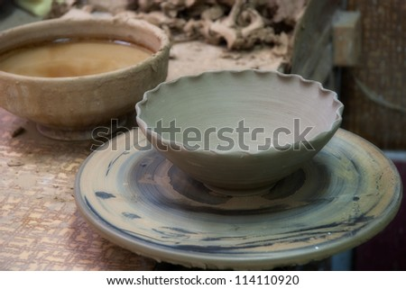 Potter's workplace with unfinished pot