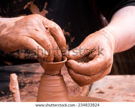 potter working at a medieval fair, creating a jar.