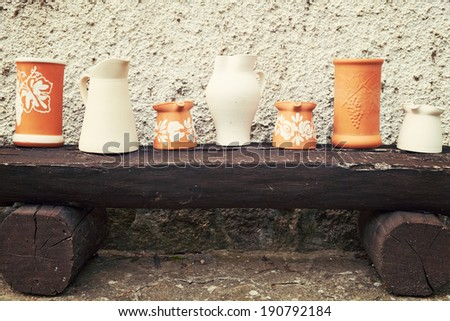 Potteries on the bench - stock photo