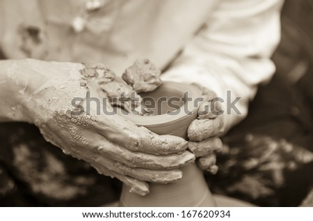 Potters Hands - stock photo