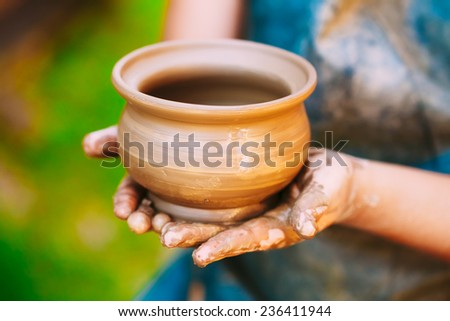 Pottery Craft Wheel Ceramic Clay Potter Human Child Hands. Toned Instant Photo - stock photo