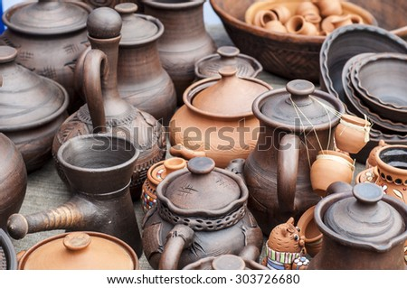 pottery, earthenware, clayware, crockery, stoneware. a large container, typically earthenware,  with a handle and a lip, used for holding and pouring liquids. - stock photo