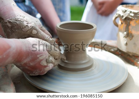 Pottery - formation process of the clay dish with traditional method as the history lesson - stock photo