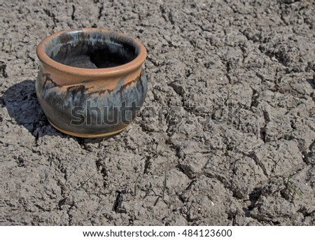 Pottery on Dried Cracked Ground