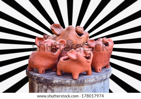 Pottery pig laughing on white black beam - stock photo