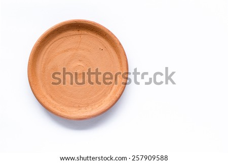 Pottery plate isolated on a white background - stock photo