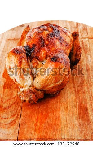 poultry : fresh grilled whole chicken on wooden cutting board isolated over white background - stock photo