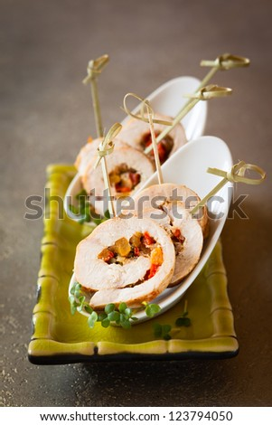 Poultry roulade filled with pumpkin and red pepper - stock photo
