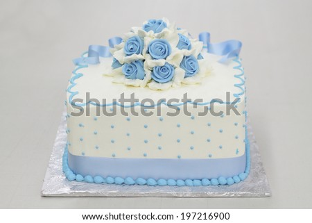 Pound Cake decorated with Blue Rose Frosting - stock photo