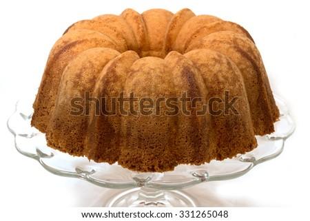 Pound cake on cake plate.  Isolated on white background.  - stock photo