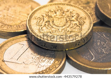 Pound Coins and Euro coins with macro shot - stock photo