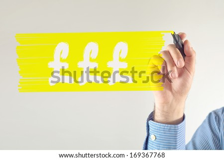 Pound currency symbol. Businessman drawing pound currency symbol with pen.