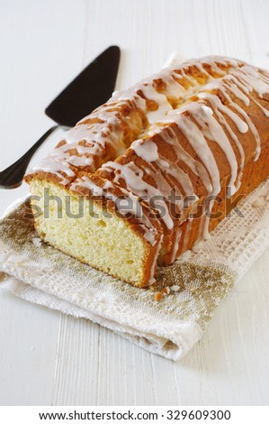 Pound Lemon Cake with apple jam and white glaze on a white background - stock photo