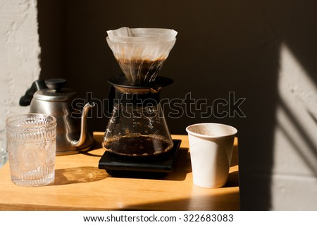 pour over coffee brewing method whole process wood and concrete background trendy cool shadows natural light background