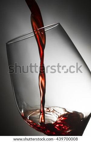 Pour red wine - stock photo