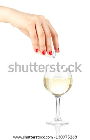Pour something into glass with drink isolated on white
