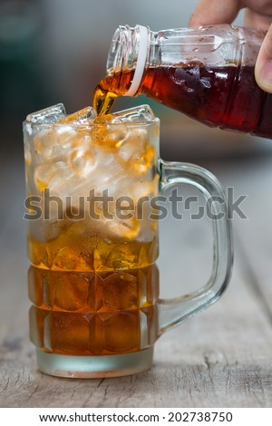 Pour the tea into a glass with ice