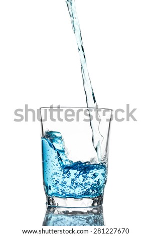Pour water in glass isolated on white background