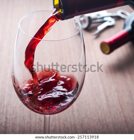 Poured wine drink in glass - stock photo