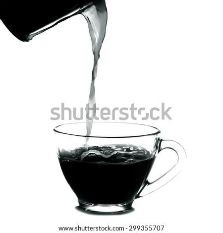 pouring a cup of coffee.Isolated on white background.Black and white