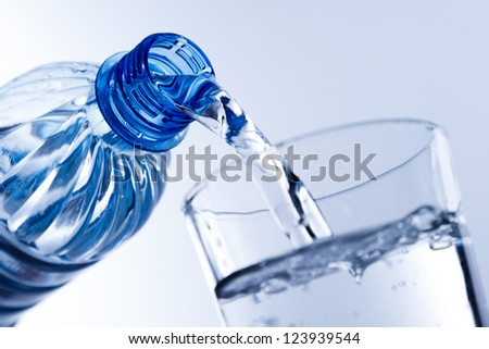 pouring a drink - stock photo