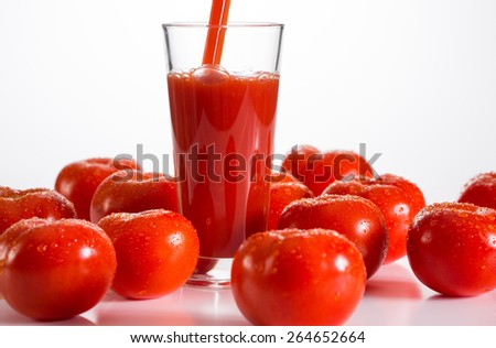 Pouring a glass of tomato juice - stock photo