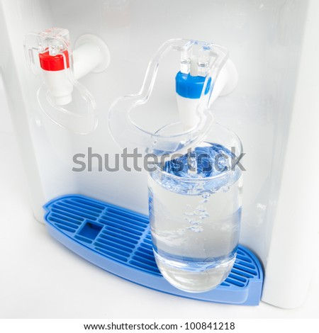 pouring a glass of water from dispenser - stock photo