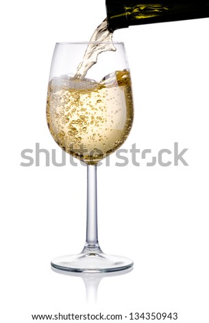 Pouring a glass of white wine isolated on a white background