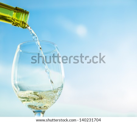 Pouring a glass of wine - stock photo
