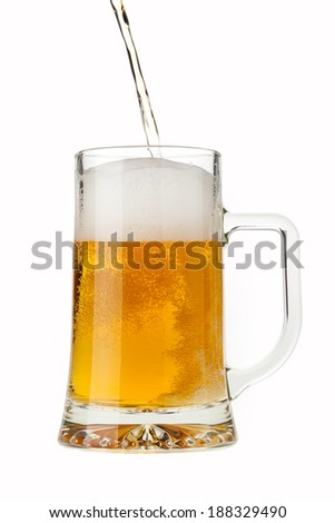 Pouring a pint glass of foamy sparkling beer