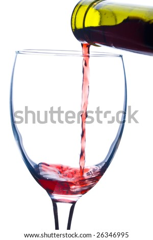 pouring a wine in glass - stock photo