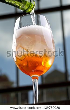 pouring aperitif - stock photo