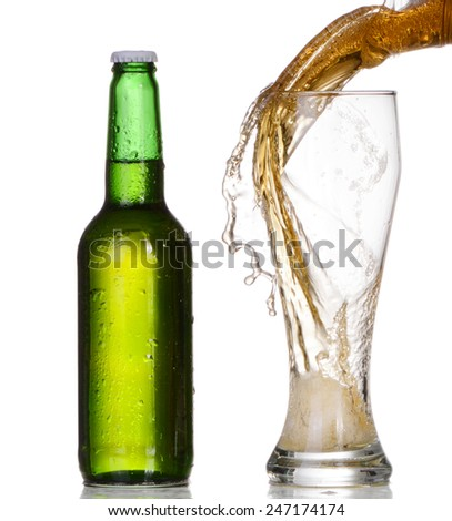 Pouring beer from bottle isolated on white background - stock photo